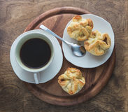 Coffee and puff pastry snack Stock Photography