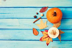 Coffee, pumpkin and spices Stock Images