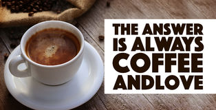 Coffee Quote. Over cup of coffee on wooden surface stock photo