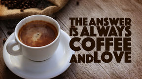 Coffee Quote. Over cup of coffee on wooden surface stock photography