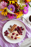 Coffee and raspberry quiche. Delicious cottage cheese quiche on plate Stock Photography