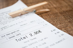 Coffee receipt on terrace table Stock Photos