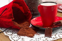 Coffee in a red cup Royalty Free Stock Images
