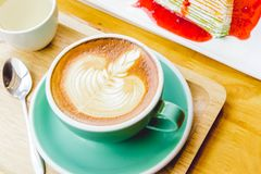 Coffee red cup cappuccino and cake on table.  royalty free stock photos