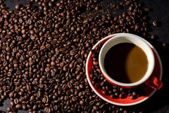Coffee in red cup and coffee beans are the background. Stock Photography