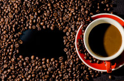 Coffee in red cup and coffee beans are the background. Royalty Free Stock Photos