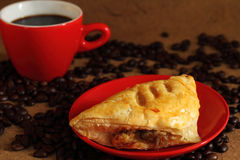Coffee red cup  and mushroom puff pastry. Royalty Free Stock Photo
