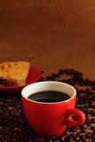 Coffee red cup  and mushroom puff pastry. Royalty Free Stock Image