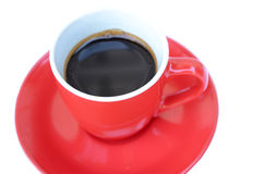 Coffee in a red cup on a red saucer Stock Photos