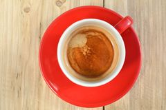 Coffee in red cup on wood Royalty Free Stock Photography