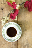 Coffee with red flower on wooden  background Stock Photos