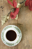Coffee with red flower on wooden  background Stock Images