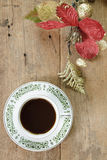 Coffee with red flower on wooden  background Royalty Free Stock Photo
