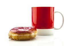 Coffee in red mug with donut Stock Photography