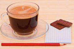Coffee, red pen and chocolate Royalty Free Stock Images
