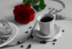 Coffee, red rose, bun and a sugar stick Stock Photography