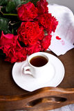 Coffee and red roses for Valentine's day Royalty Free Stock Image