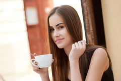 Coffee refreshment. Beautiful young woman having some coffee refreshment stock image