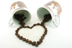 Coffee results in a heart of two cups. Isolated Stock Image