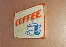 Coffee  retro vintage label. Retro vintage coffee label on the wall Stock Images