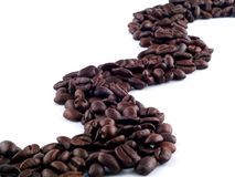 Coffee River of Beans. Coffee beans flowing in a river from one end of the frame to the other Stock Images