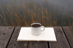 Coffee, river and blank pages Stock Photography