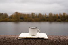 Coffee, river and blank pages Stock Photo