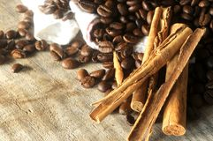 Coffee roast aromatic beans and cinnamon sticks Stock Image