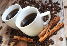 Coffee roast aromatic beans and two cup of coffe mugs Stock Images