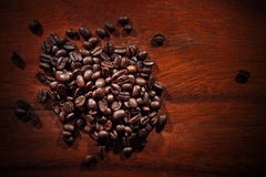 Coffee roast bean on wood textured Stock Photography