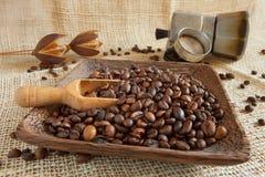 Coffee roasted beans next to an Italian moka Stock Photo