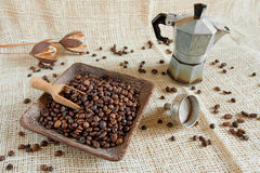 Coffee roasted beans  next to an Italian moka Royalty Free Stock Photo