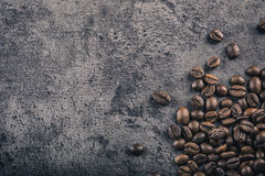 Coffee. Roasted coffee beans spilled freely on a concrete background Stock Images