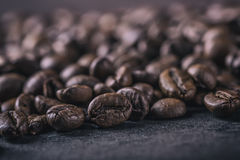 Coffee. Roasted coffee beans spilled freely on a concrete background Royalty Free Stock Photos