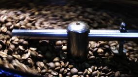 Coffee Roasting Machine. The Coffee Roasting machine. You have to be there. After it is ready, the taste and smell is enough to make you awake. We made our stock footage