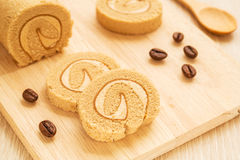 Coffee roll cake on wooden board Stock Photos
