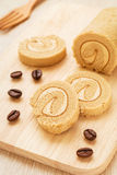Coffee roll cake on wooden board Royalty Free Stock Images