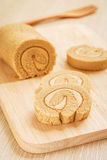 Coffee roll cake on wooden board Stock Photography