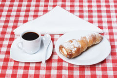 Coffee, rolls with cream tablecloth Royalty Free Stock Photo