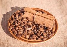 Coffee romantic wedding. Coffee beans and cinnamon sticks Stock Photos