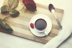 Coffee and rose on bed. Bed breakfast coffee and rose on bed Royalty Free Stock Images
