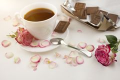Coffee rose and chocolate on a white background romantic stock photography