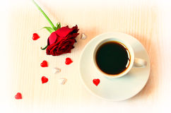 Coffee and rose. Composition of coffee, roses and hearts on the wooden background royalty free stock photography