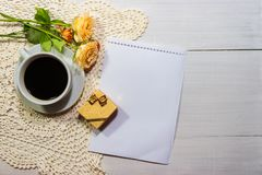 Coffee with roses and gift on the rustic table stock images