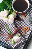 Coffee and roses on a tray Stock Photography