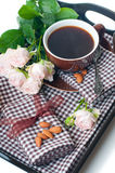 Coffee and roses on a tray Stock Photo