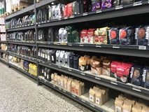 Coffee in rows on shelves in a supermarket. Copenhagen, Denmark - April 19, 2019 royalty free stock photography