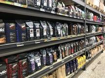 Coffee in rows on shelves in a supermarket. Copenhagen, Denmark - April 19, 2019 royalty free stock photo