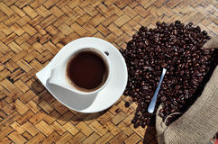 Coffee and sac on wooden surface Stock Photography