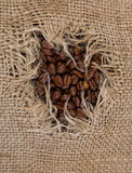 Coffee sack. A hole in coffee sack Royalty Free Stock Photography